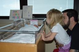 Sister Meeting Baby